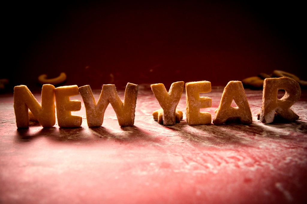 New Year cookies with sugar powder on red background